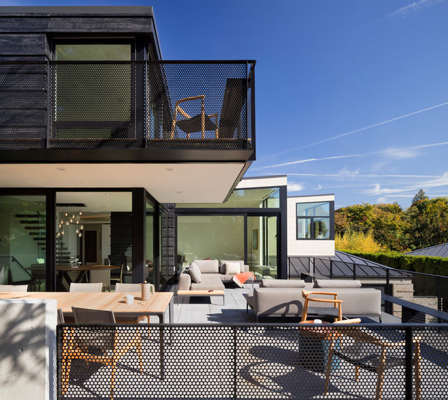 Modern Glass Project in Seattle Home with Outdoor Patio.